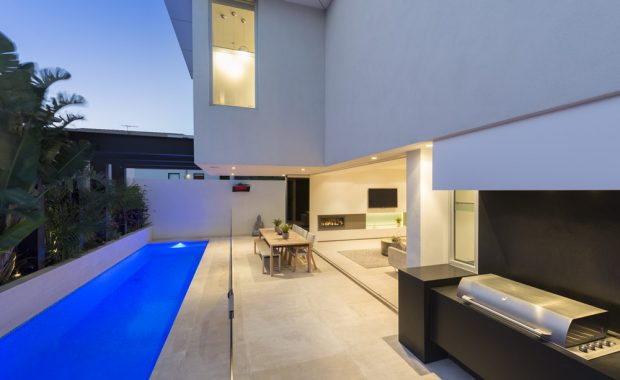 luxury outdoor area with pool, outdoor kitchen and entertaining