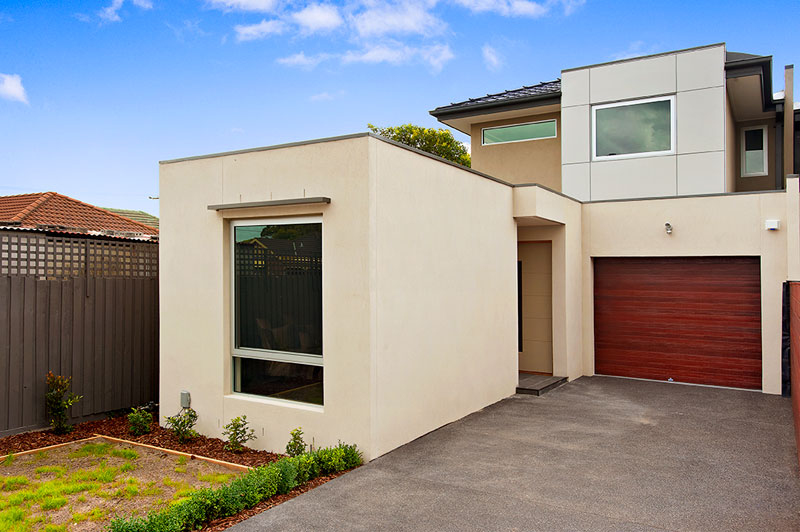 townhouse drive, wooden garage door and concealed entrance
