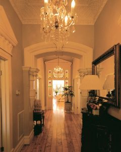 Queen Anne hallway with floor boards, lead light door frame into back living area
